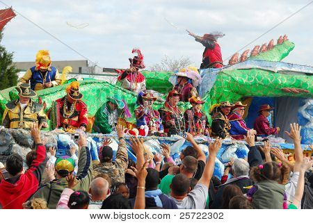 PENSACOLA, FLORIDA - FEBRUARY 22:  Revelers beg for beads at the Grand Mardi Gras parade in Pensacola, Florida on February 22, 2009. Mardi Gras is a huge tourism draw celebrated here since 1874.