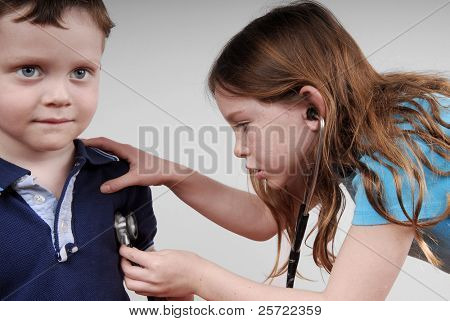 Young kids with stethoscope playing doctor
