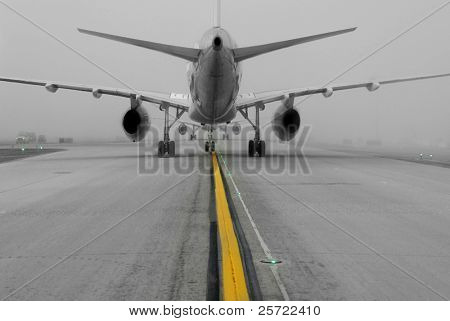 aircraft taking off on foggy runway