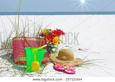 collection of colorful beach supplies on deserted shore