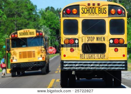 school bus on rural road picking up children