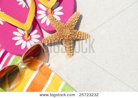 beach supplies on sand for fun summer holiday