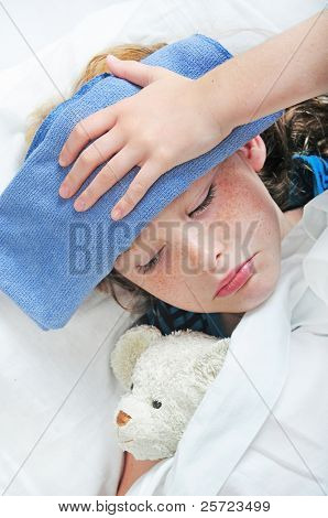 young girl in bed feeling unwell