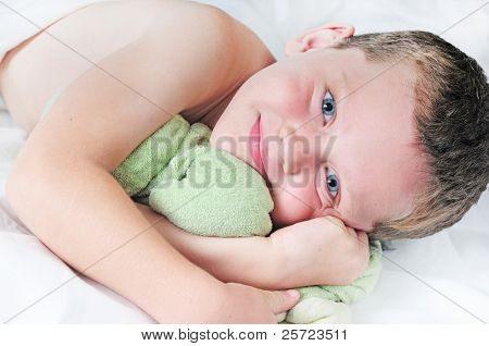Cute young boy cuddling animal at naptime