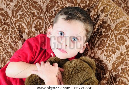 Young boy with wide eyes after being frightened