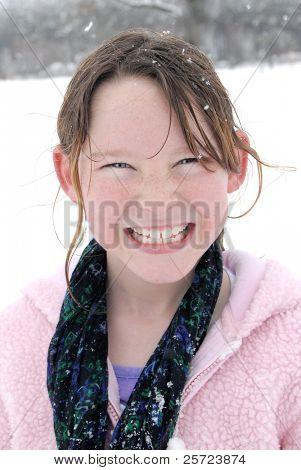 Young girl having fun in fresh snow