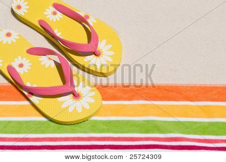 flip flops on beach towel
