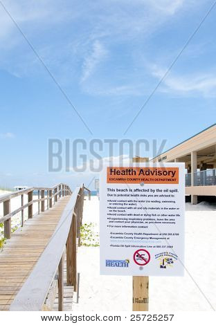 PENSACOLA BEACH - 23 JUNE:  A warning sign at the entrance to Pensacola Beach, FL warns swimmers on June 23, 2010 that the Gulf of Mexico waters are closed due to the BP oil spill.