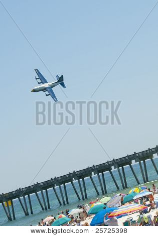 "PENSACOLA BEACH - 8 JULY: The U.S. Navy Blue Angels flight demonstration team perform over Pensacola Beach, Florida on July 8, 2010 as part of the annual ""Blues on the Beach"" airshow."
