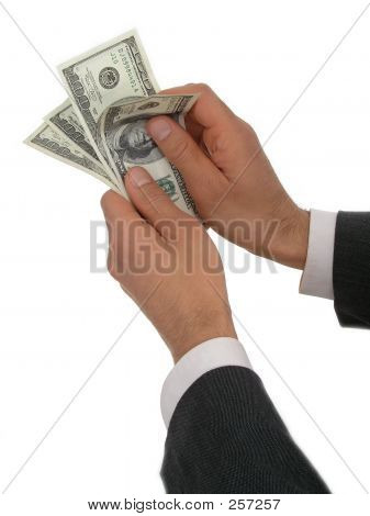 Businessman's Hands Counting Money