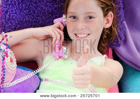girl getting good news on phonecall