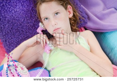 Young girl thinking seriously on  phone