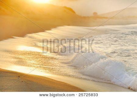 Sun rising over foggy ocean in Carmel, California