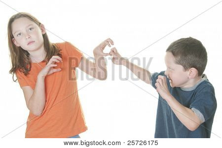 Young boy and girl being physical