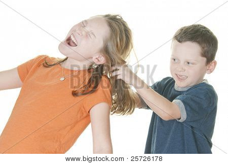 young boy pulling girl's hair