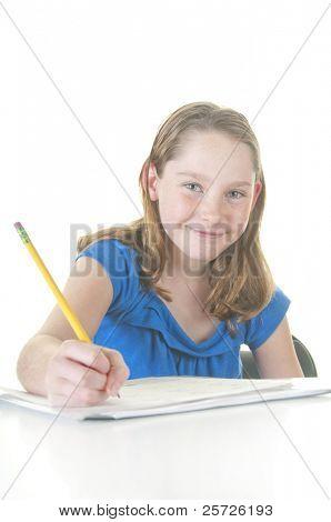 Happy girl working on school assignment