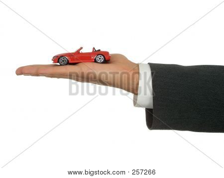 Businessman's Hand Holding Toy Car