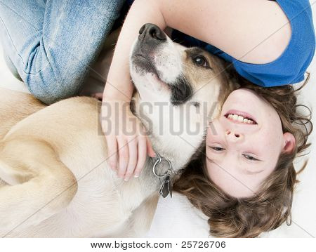Young girl happy to lay with dog