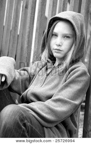 girl in hooded jacket outside