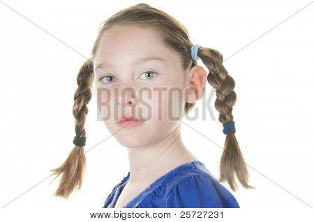 girl looking serious in braids