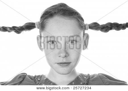 girl with long braids looking silly