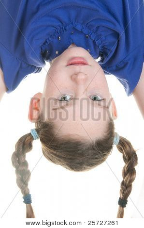 silly girl hanging upside down