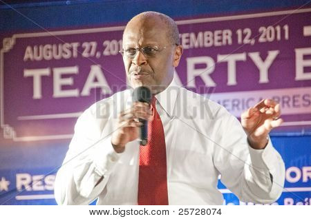 TAMPA - SEPTEMBER 12: Republican candidate Herman Cain addresses supporters after the CNN/Tea Party Express debate in Tampa, Florida on September 12, 2011.