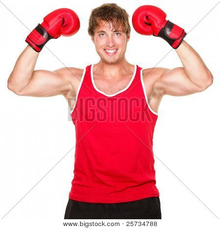 Fitness boxing man showing strength flexing muscles. Handsome strong fit boxer smiling happy wearing red boxing gloves isolated on white background.