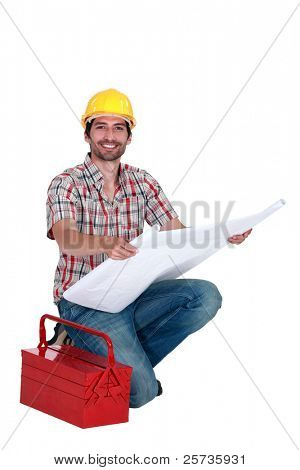 Happy foreman observing a blueprint