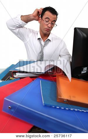 Office worker surrounded by paperwork