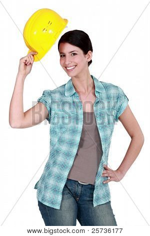 Woman tipping her hard hat