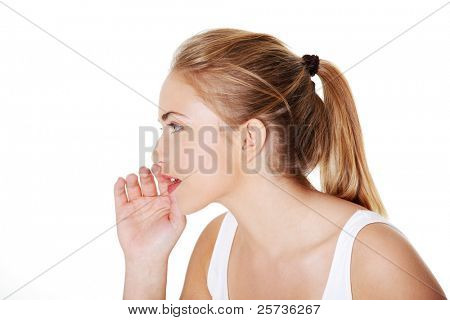 Teen woman whispering gossip to somebody