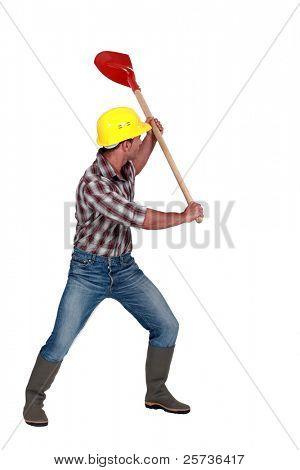 Workman brandishing a shovel on white background