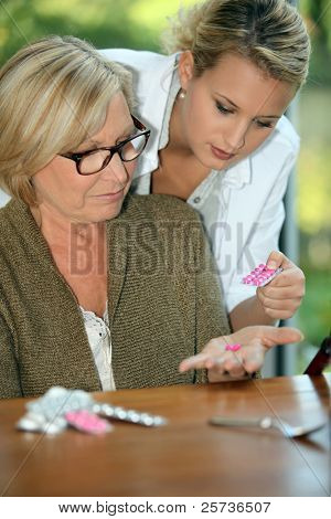 Woman looking at her pills