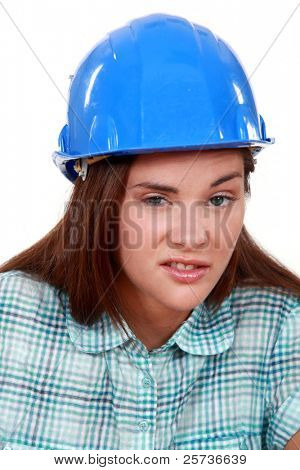 Young woman laborer grimacing