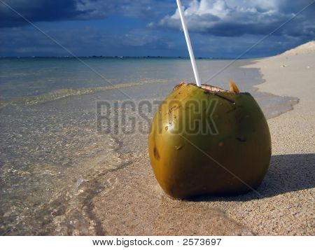 Open Coconut On Tropical Beach And By Water