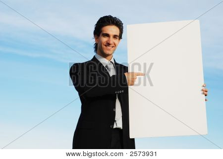 Businessman Holding Blank Board