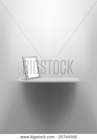 White wall shelf with blank photo frame.