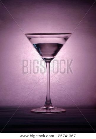 Martini glass on violet lightening background