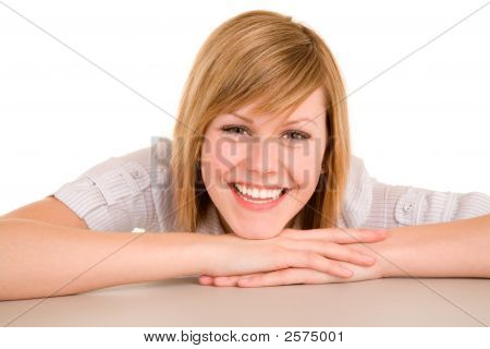 Smiling Woman Laying On Her Desk