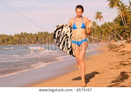 Woman Walking With Boogie Board
