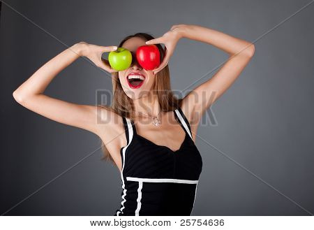 Young Happy Woman With Two Apple