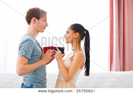 Romantic Couple Exchanging Gifts