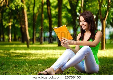 woman reading book and smiling