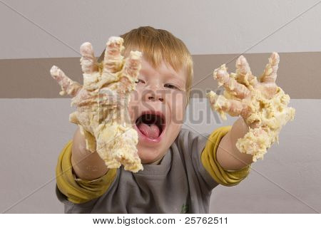 Boy With Sticky Hands Full Of Dough