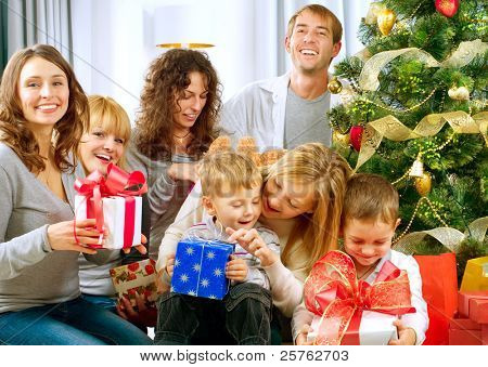 Happy Big family holding Christmas presents at home.Christmas tree
