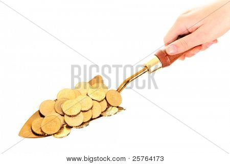 A picture of a small shovel full of golden coins over white background