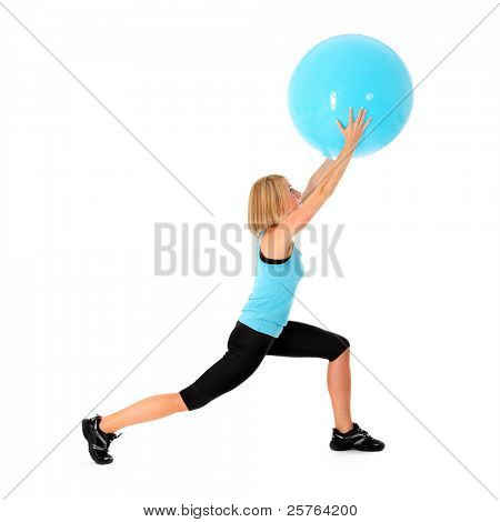 A picture of a beautiful young fit woman exercising with a ball over white background