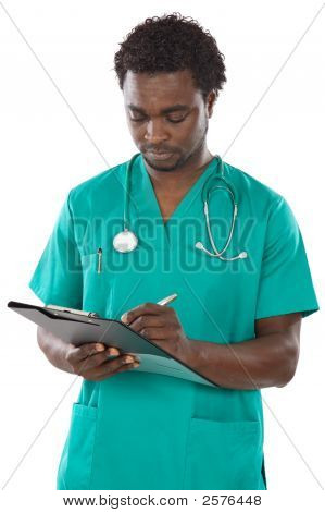 Young Black Doctor Writing
