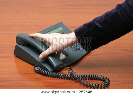 Hand Reaching For Telephone